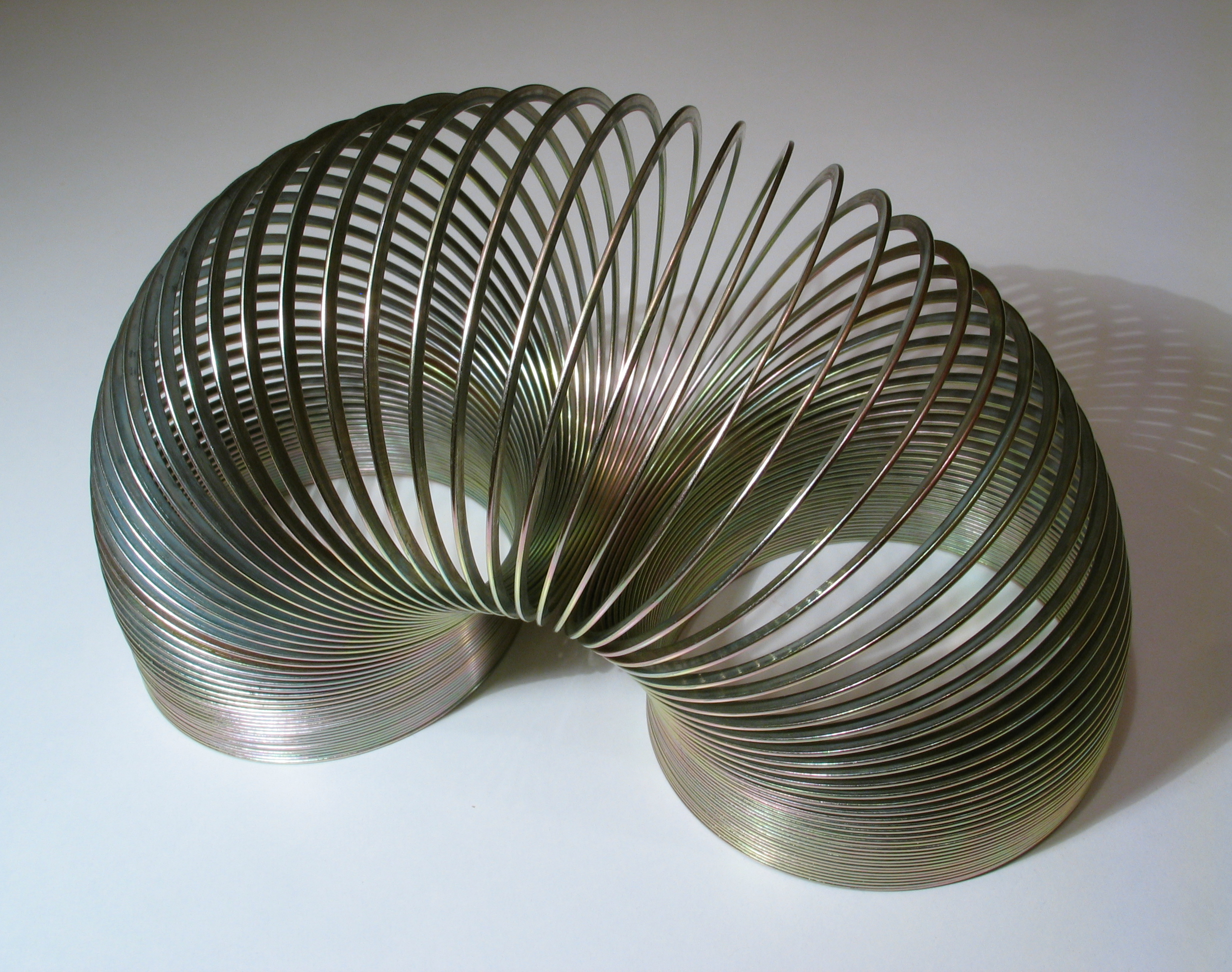classic silver slinky in arc shape