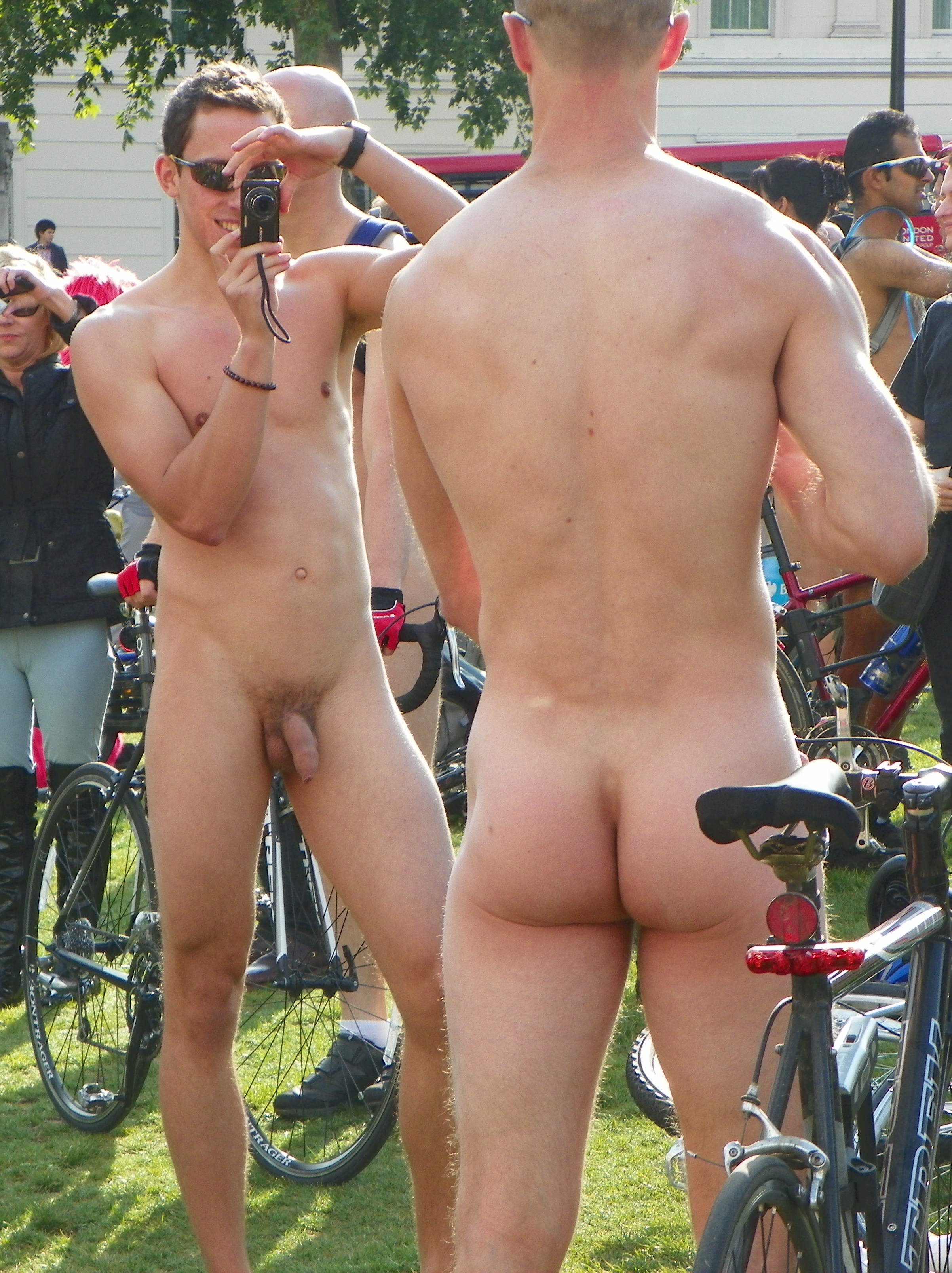 nude young boys on bicycles