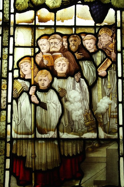 Stained glass windowc depicting a church procession