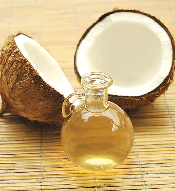 Coconut oil and a coconut split in half
