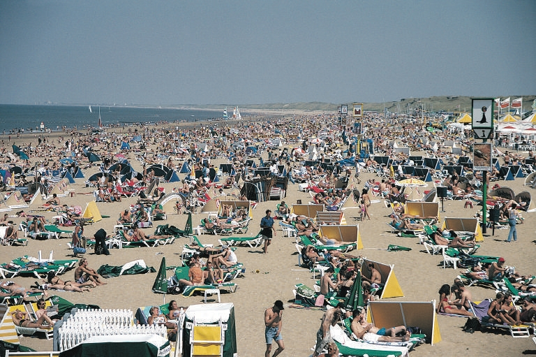 File:Crowded Netherlands beach with mostly adults.jpeg