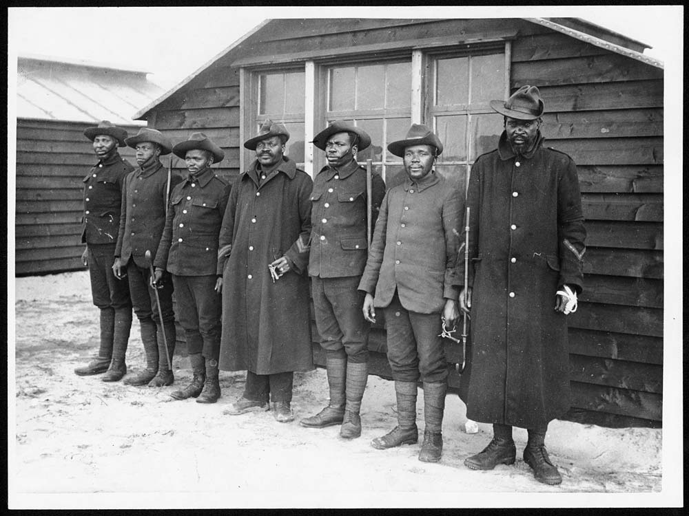 File:This is one of a series of photographs of Labour Corps members. The caption identifies these seven men as 'native police'. They are probably black South Africans who had contracted to work in the (4687904751).jpg