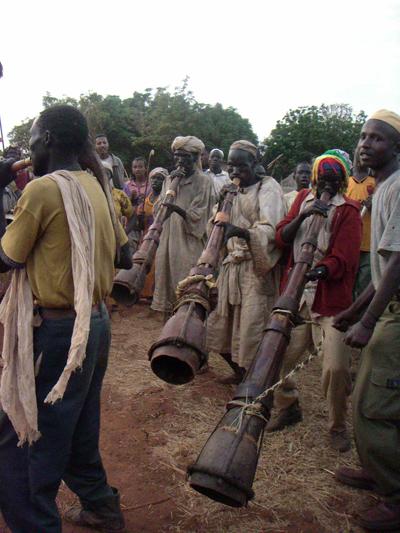 Berta people playing trumpets