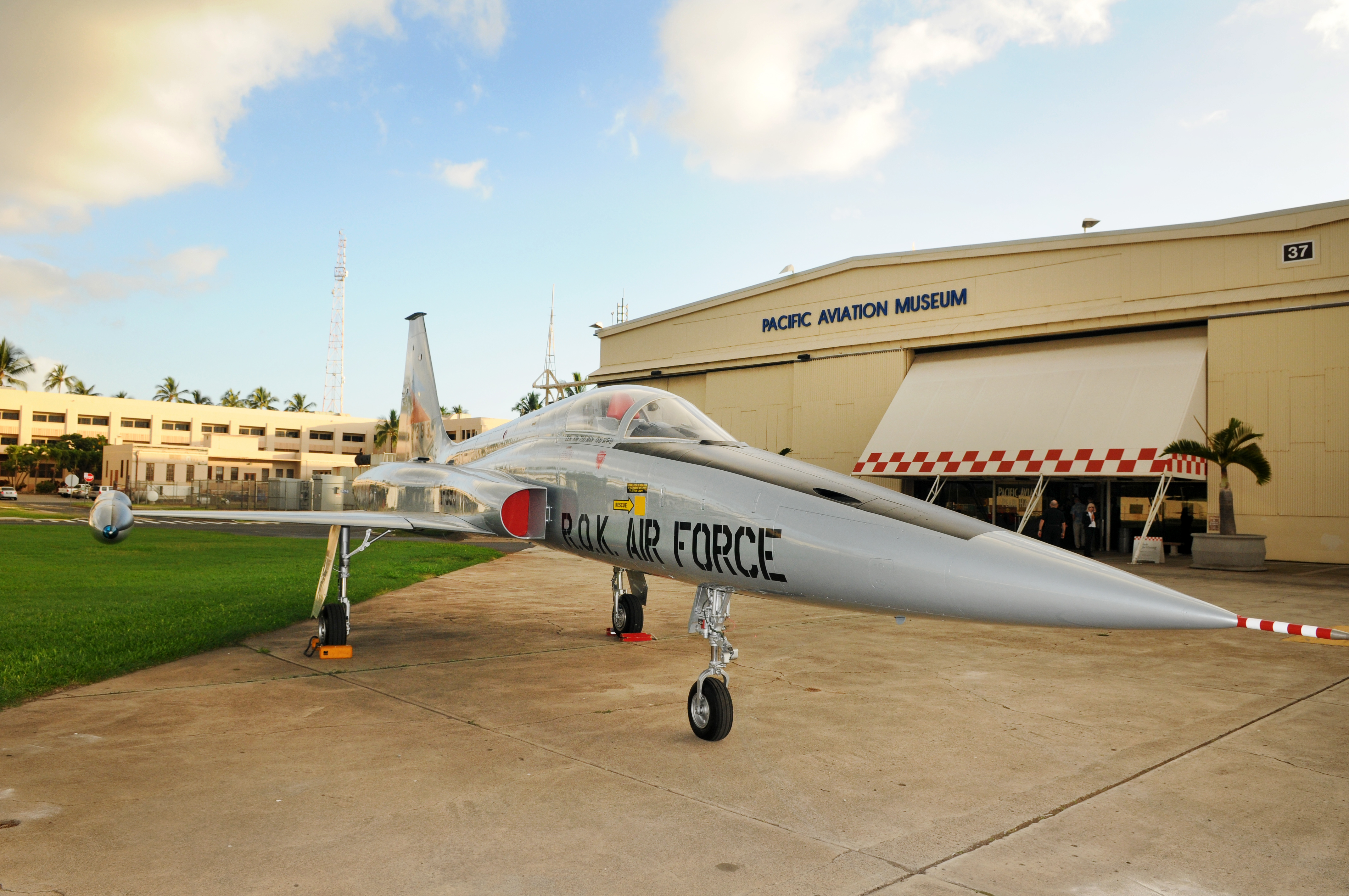 gray air force plane in front of the pacific aviation museum