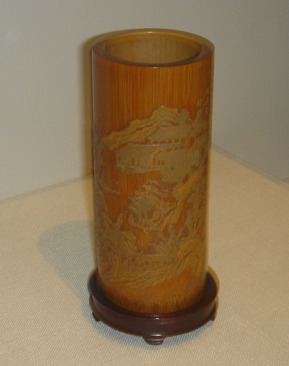 A cylindrical bamboo brush holder or holder of poems on scrolls, created by Zhang Xihuang in the 17th century, late Ming or early Qing Dynasty – in the calligraphy of Zhang's style, the poem Returning to My Farm in the Field by the fourth-century poet Tao Yuanming is incised on the holder.