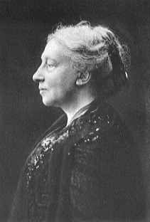 "Head and shoulders profile of a dignified older woman with hair swept back and a slightly prominent nose. Underneath is the signature ""Augusta Gregory""."