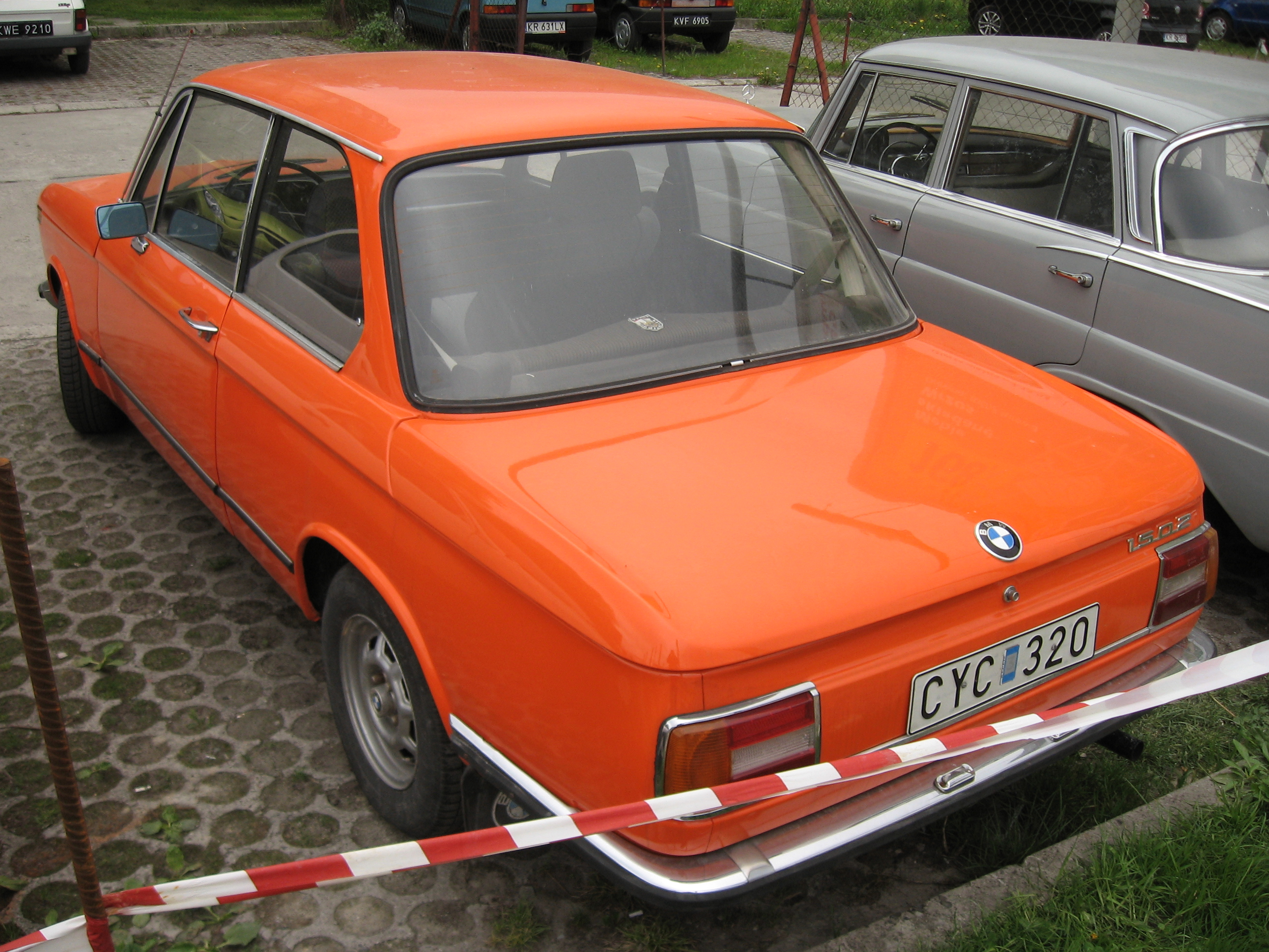 File:Orange BMW 1502 on a parking lot in Kraków (2).jpg