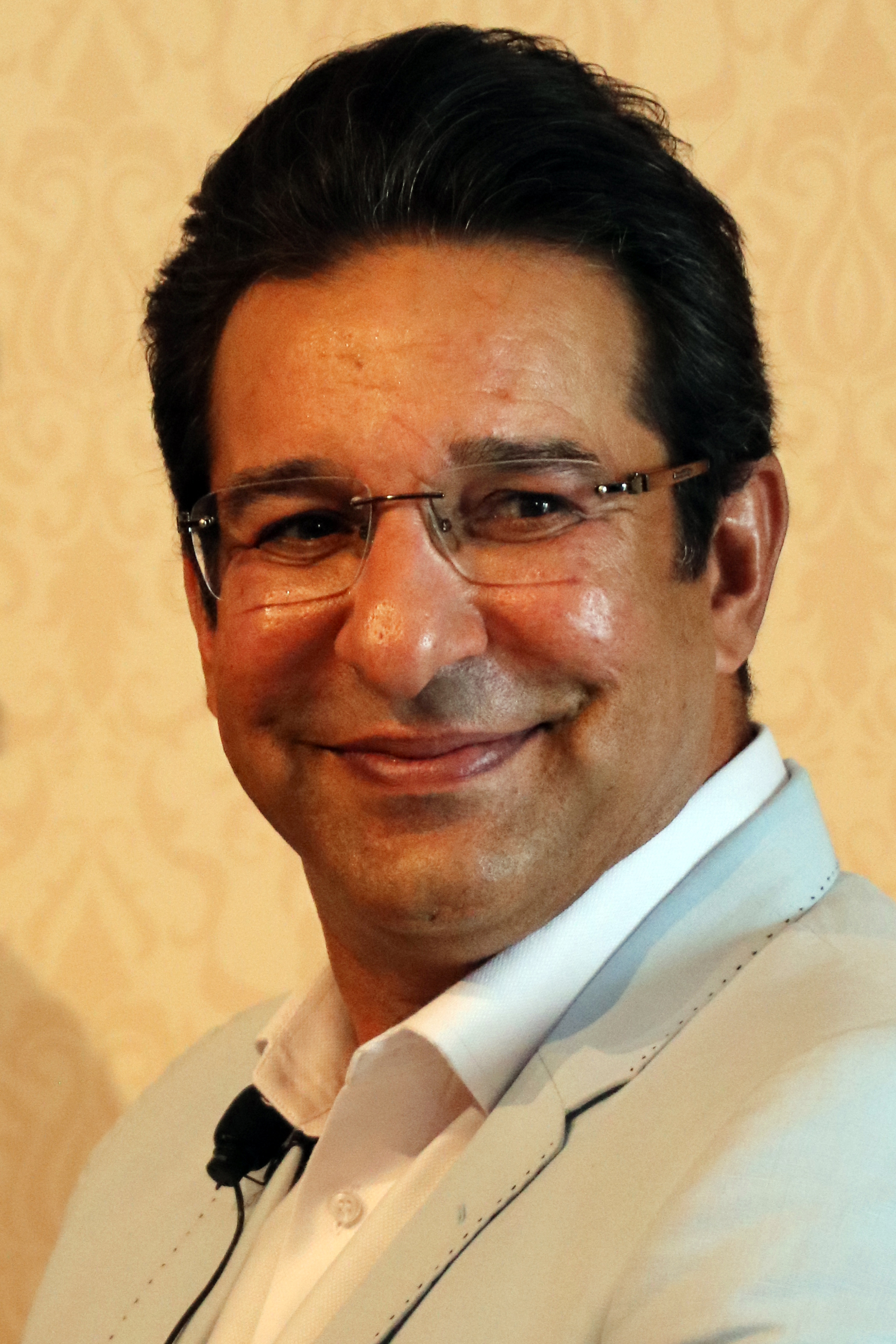 The 52-year old son of father Chaudhry Mohammad Akram and mother(?) Wasim Akram in 2018 photo. Wasim Akram earned a  million dollar salary - leaving the net worth at 23 million in 2018