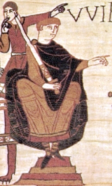 A seated man in robes holding a sword upright in one hand and pointing with his other hand. Behind the seated figure is a standing man pointing in the same direction as the seated figure.