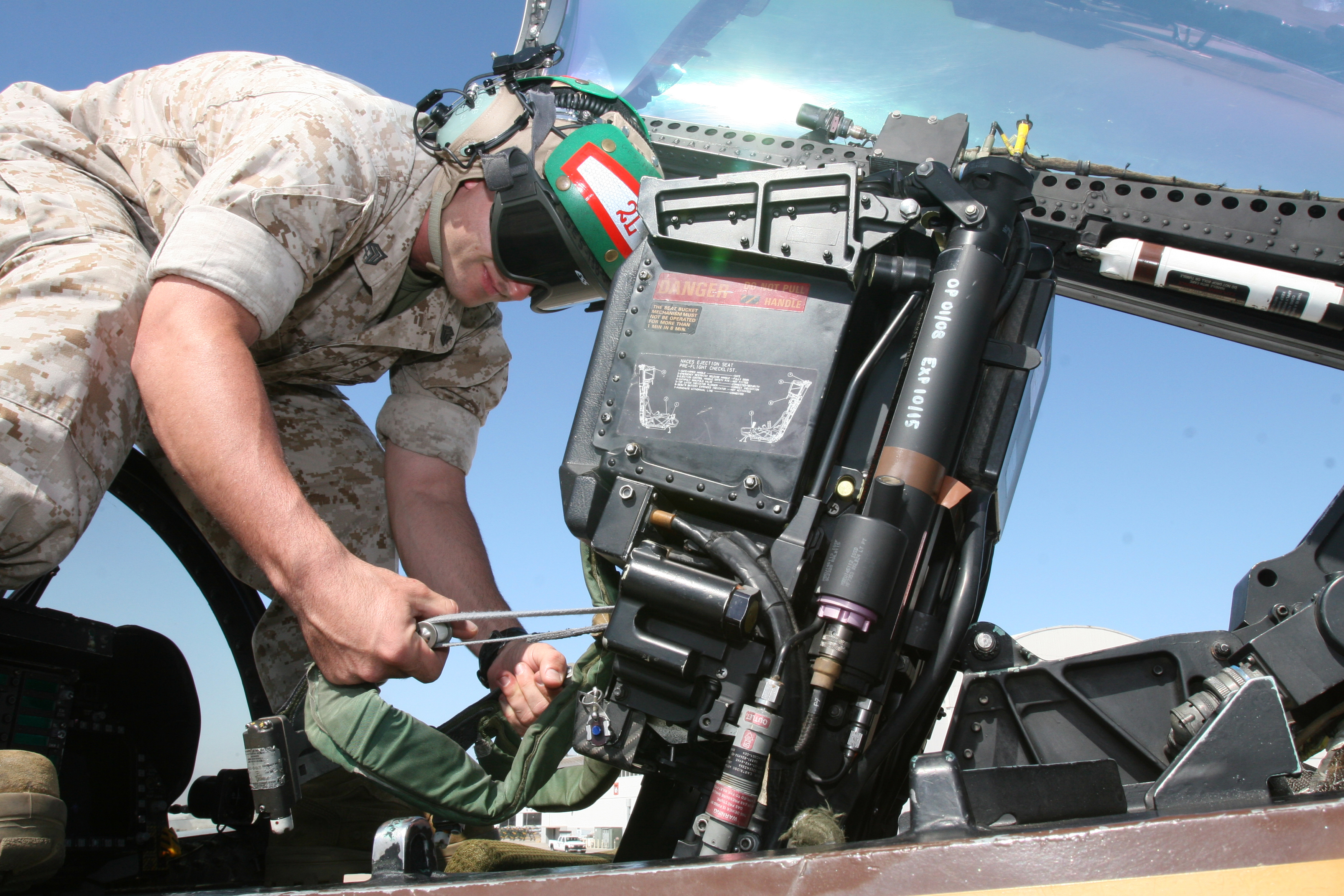 File:A United States Marine inspects an ejection seat in ...