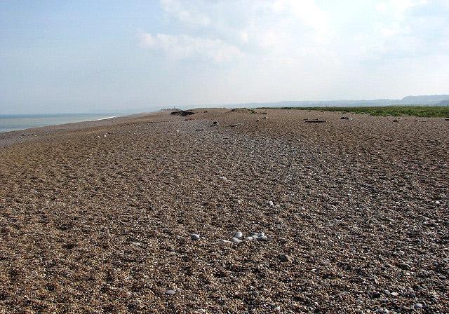 A vast shingle beach View southeast along the beach at Cley Eye.