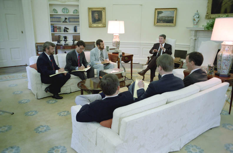 White House speechwriters meet with President Reagan in the Oval Office on May 18, 1987. Tony Dolan is on the left. (Ronald Reagan Library)