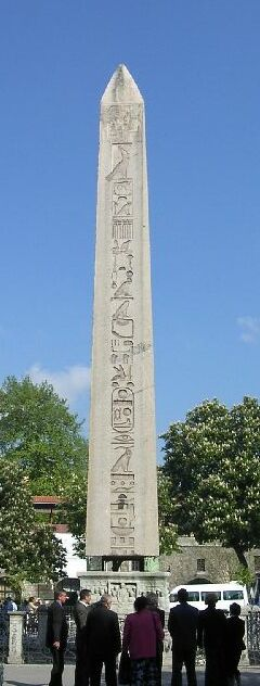 Obelisk of Thutmosis III, at the base showing Theodosius I (Roman Emperor, 379-395). The obelisk stands among the ruins of the hippodrome of the former capital of the Byzantine Empire, Constantinople, now Istanbul, Turkey. In 390, Theodosius had the obelisk cut into three pieces and brought to Constantinople. Only the top part survives, and it stands today where he placed it, on a marble pedestal. Hippodrome of Constantinople Obelisk 3.jpg