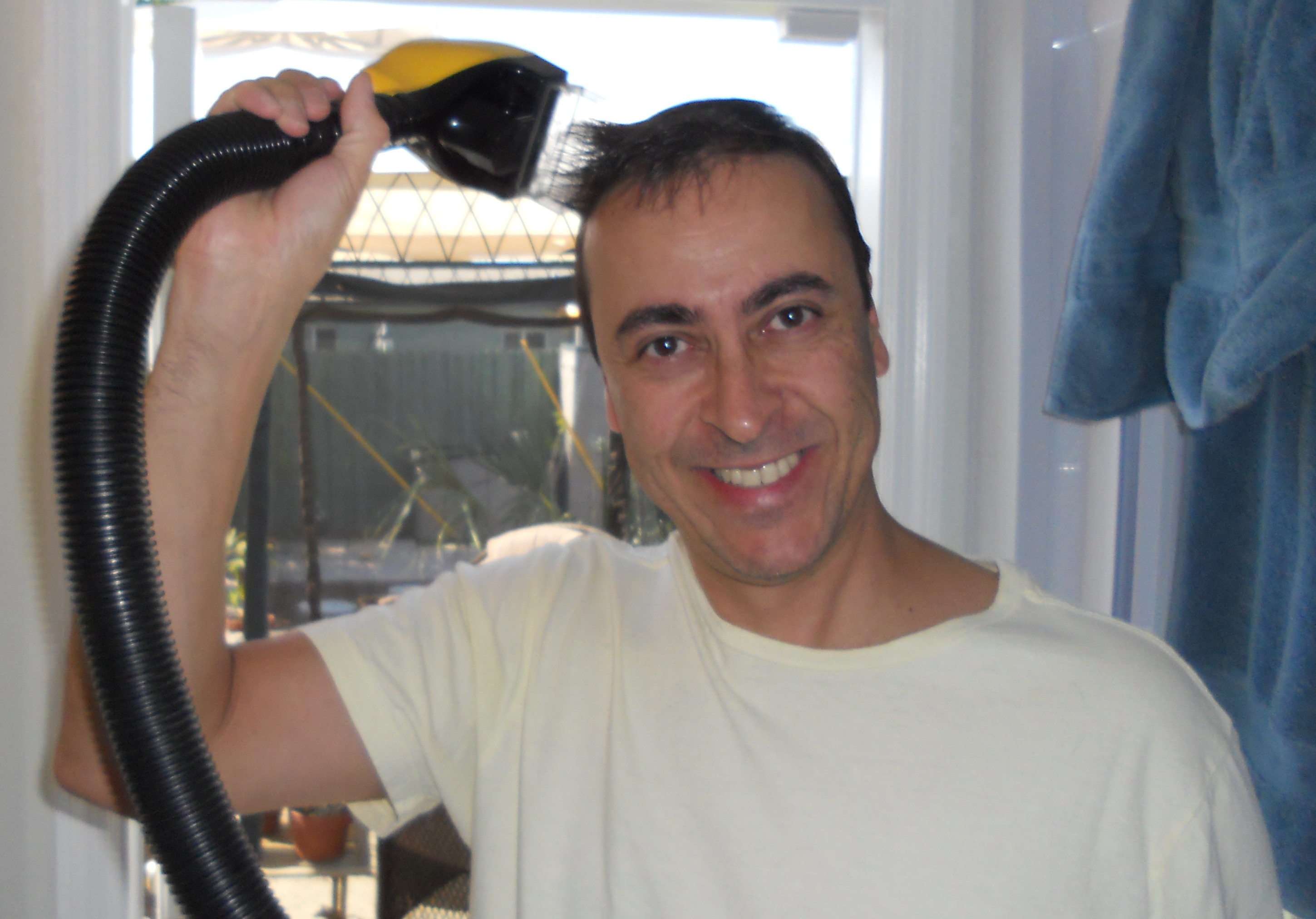 File:Man using Flowbee to cut his hair.jpg  Wikipedia, the free