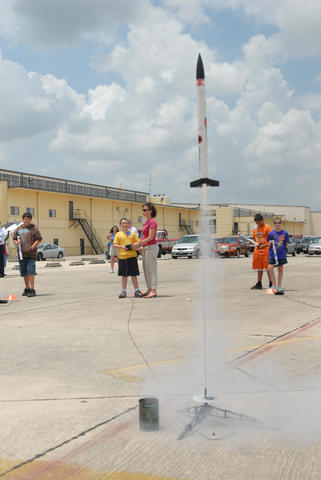 Trey Soule, center, launches his model rocket during STARBASE Kelly, a five-day summer camp providing math, science and technology education to fourth, fifth and sixth-graders. Model Rocketry at Starbase Kelly camp 070810-F-3340B-001.JPG