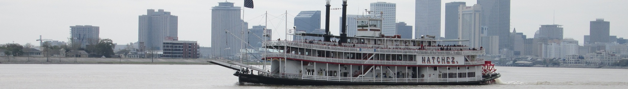 Riverboat passing New Orleans, on the Mississippi River. In Louisiana, United States.