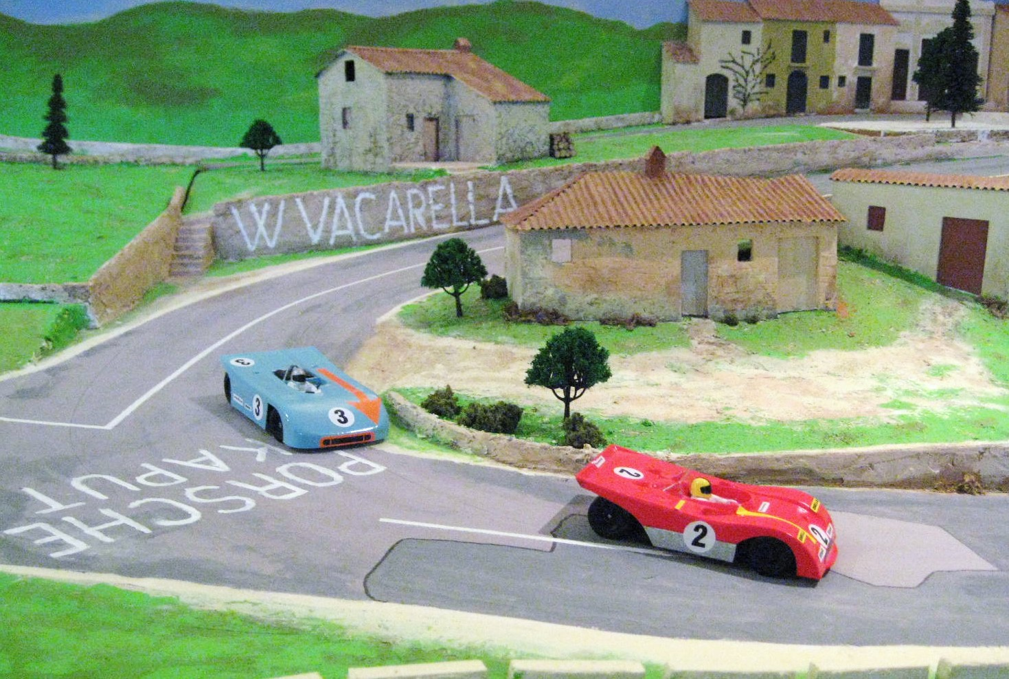 File A Magracing Ferrari And Porsche Race Out Of The Village On My Targa Florio Mountain Circuit