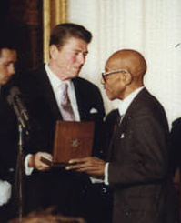 Blake receiving the Presidential Medal of Freedom from Ronald Reagan (1981) Eubie Blake Presidential Medal of Freedom.jpg