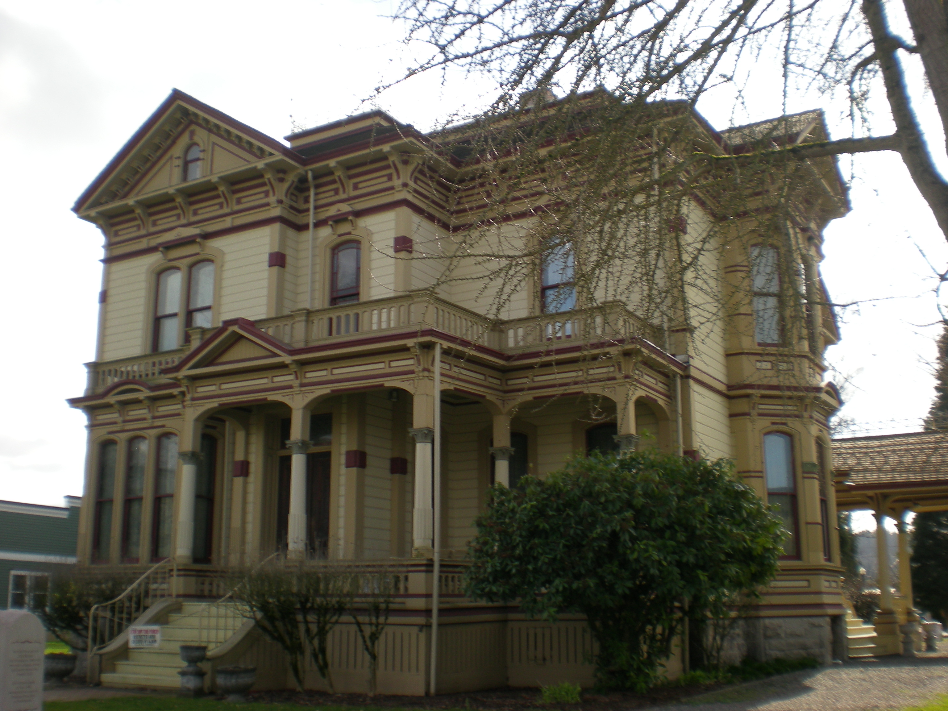 The tan and brown facade of the Meeker Mansion