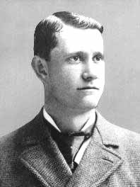 Black-and-white photo of Ed Delahanty in a suit, facing right