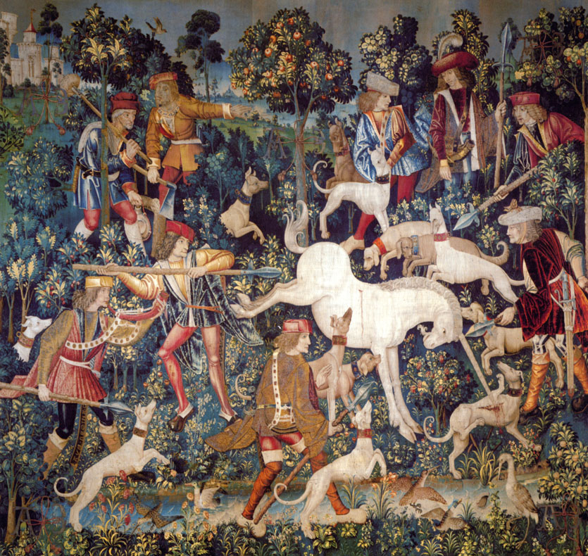 An image from the Unicorn Tapestries, in which the unicorn defends itself from attacking hounds.