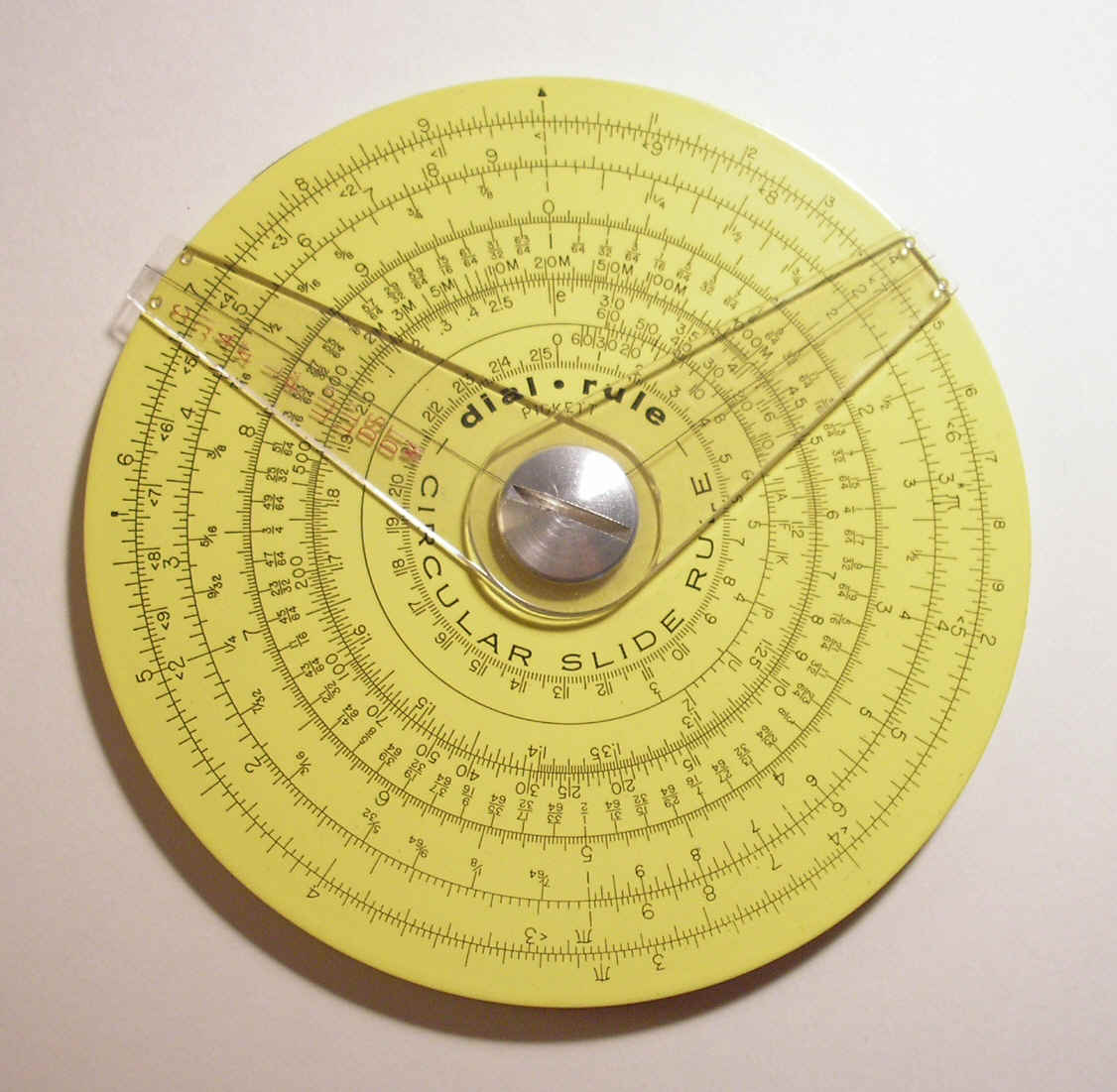 Pickett circular slide rule with two cursors. (4.25in./10.9cm width) Reverse has additional scale and one cursor.