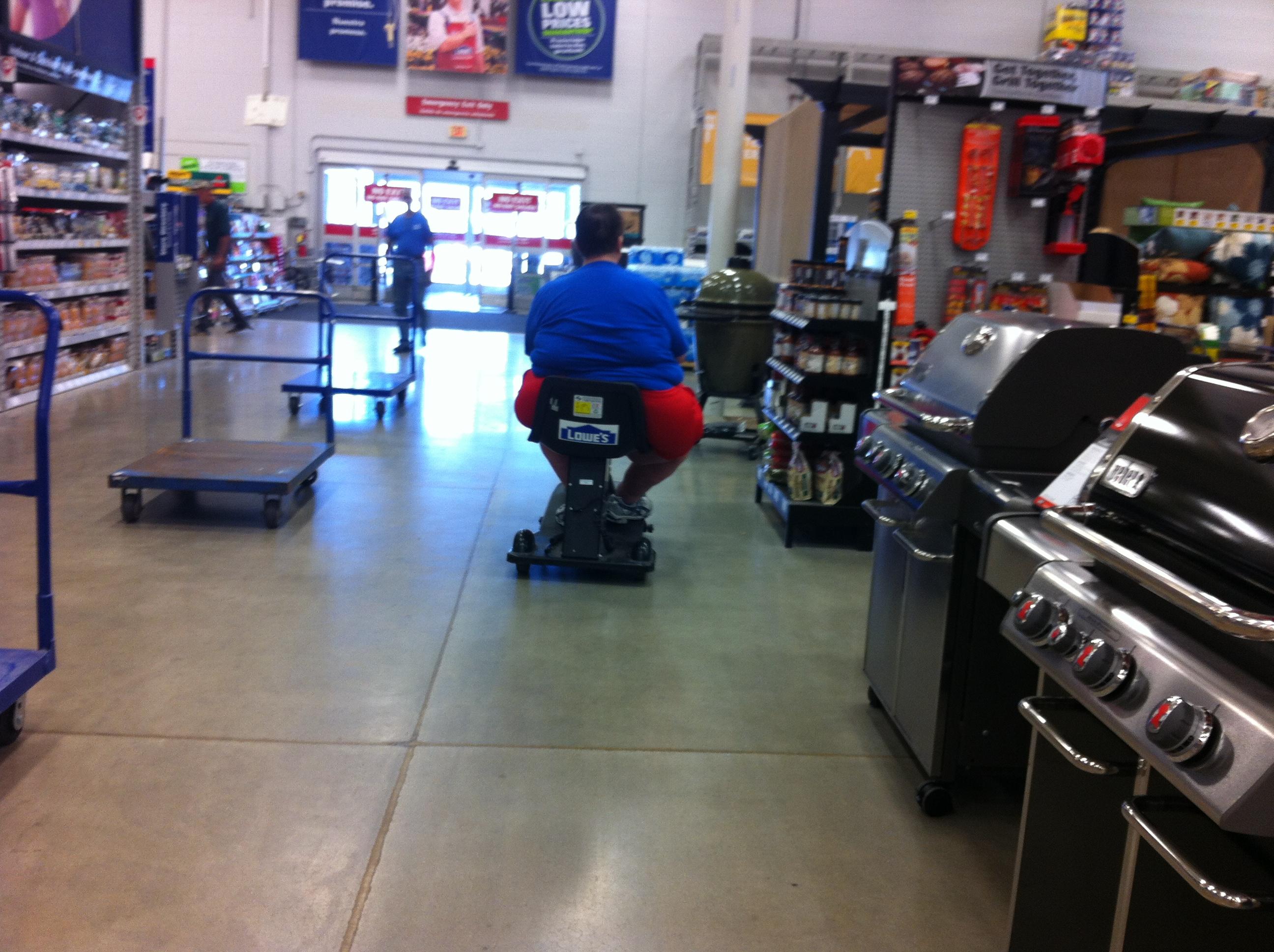 File obese customer in motorized cart at lowe 39 for Motorized cart for seniors