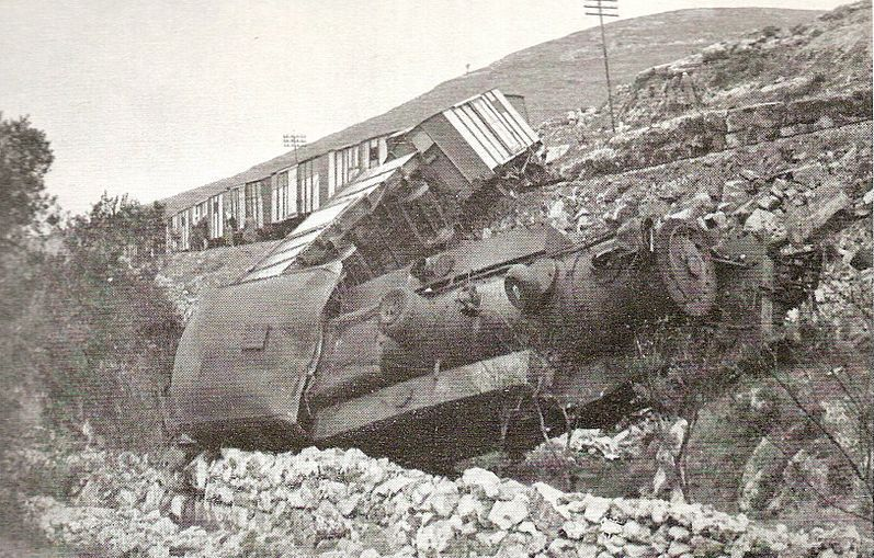 A locomotive lies, blown off its tracks by saboteurs.