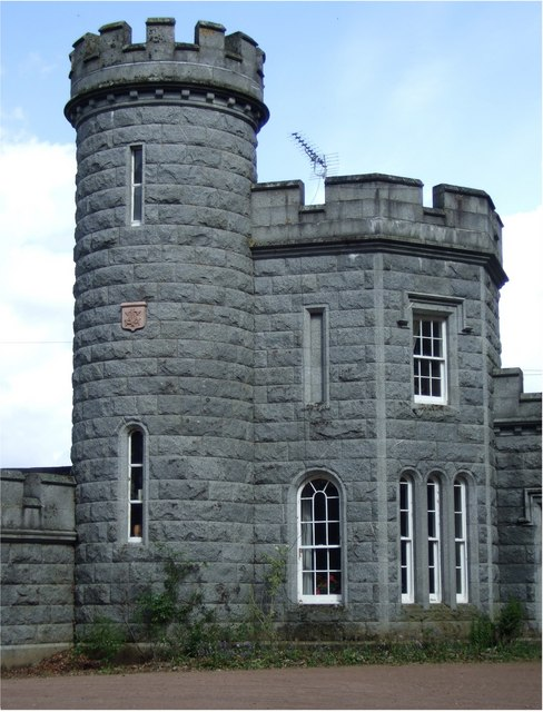 Photo of grey granite building with attached tower