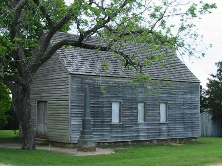 "Replica of the building at Washington-on-the-Brazos where the Texas Declaration of Independence was signed. An inscription reads: ""Here a Nation was born"". Washington on the Brazos Monument.jpg"