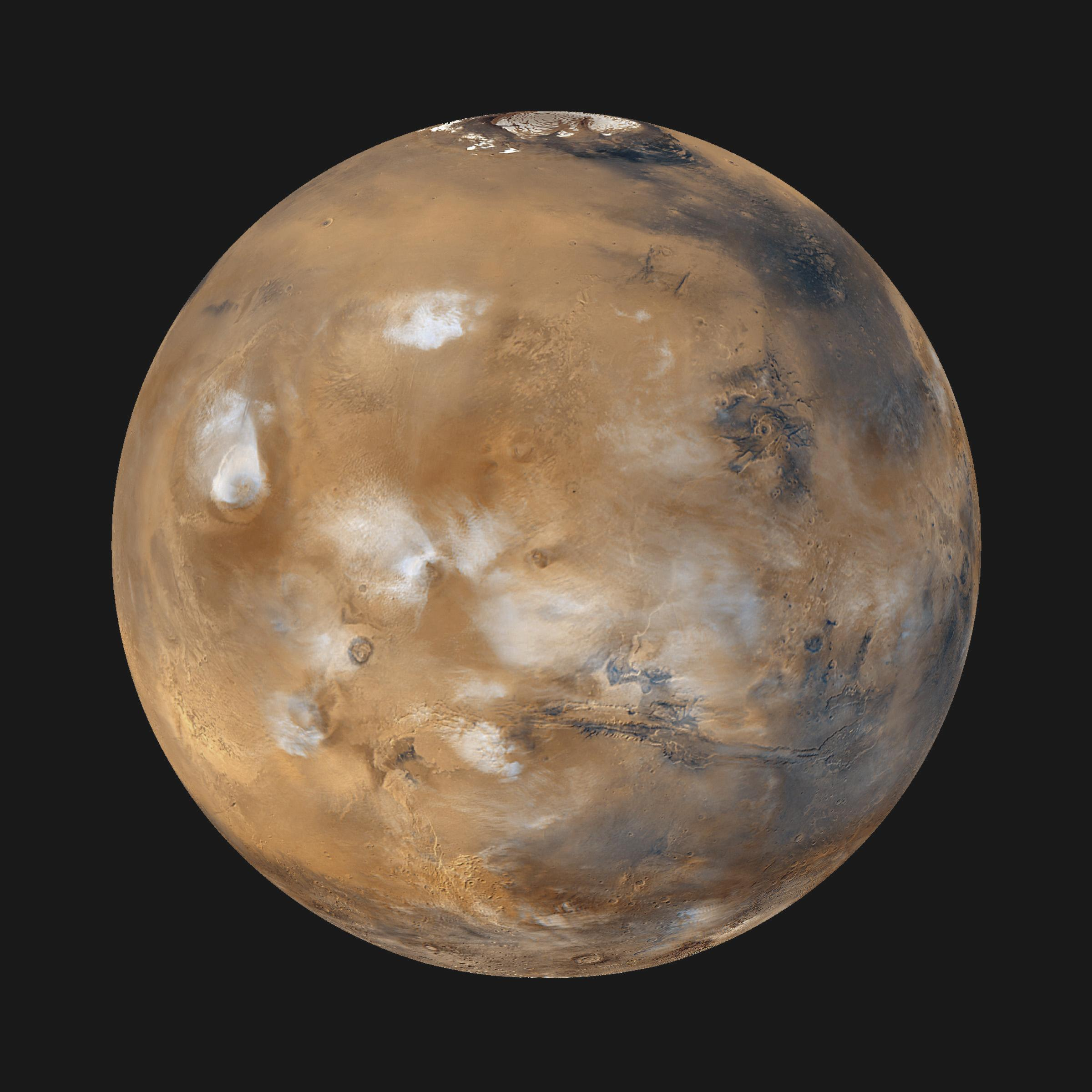 [Pilt: Water_ice_clouds_hanging_above_Tharsis_PIA02653.jpg]