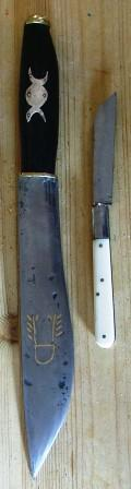 The Athame (black handle) and Boline (white ha...