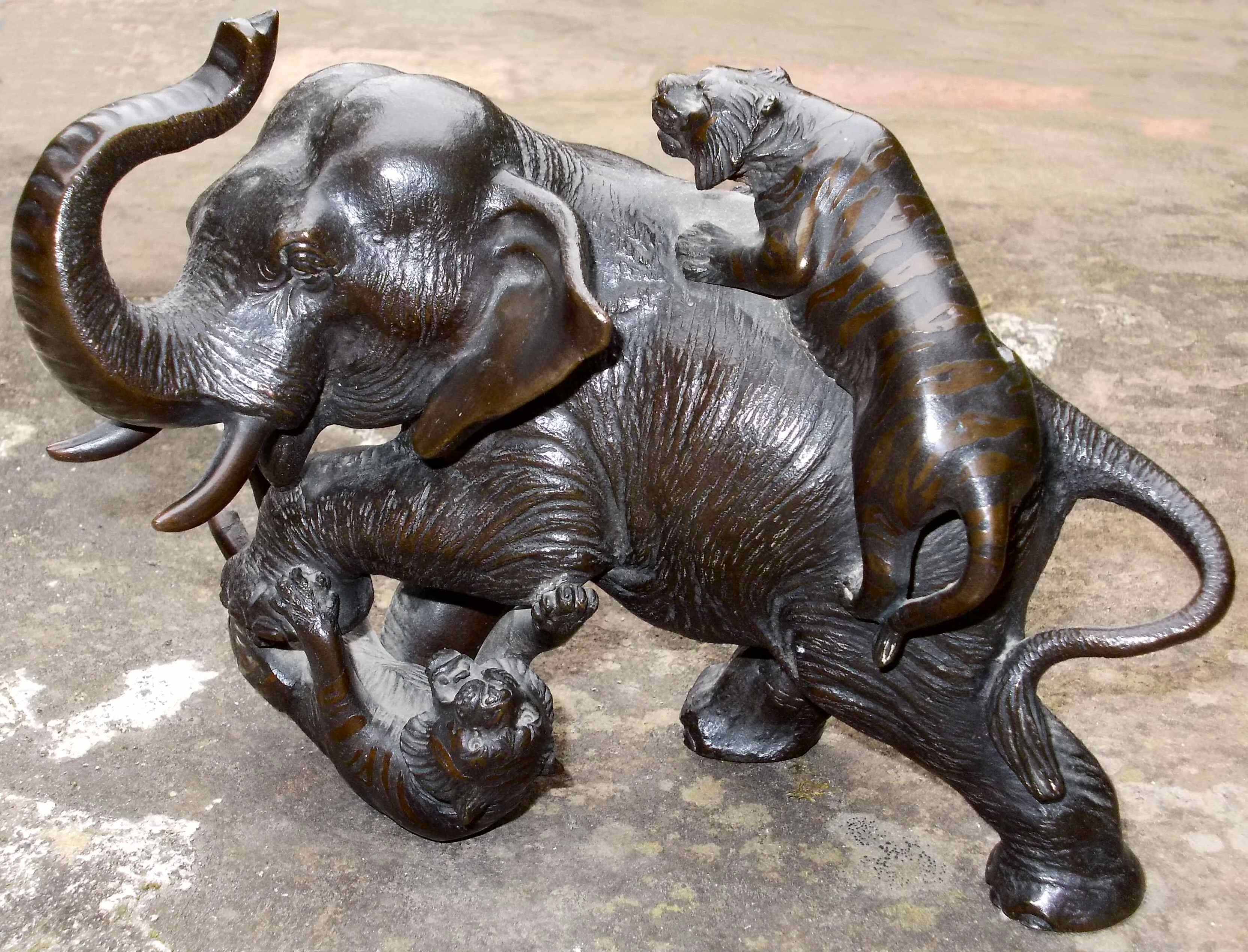 file bronze sculpture of tigers attacking an elephant jpg