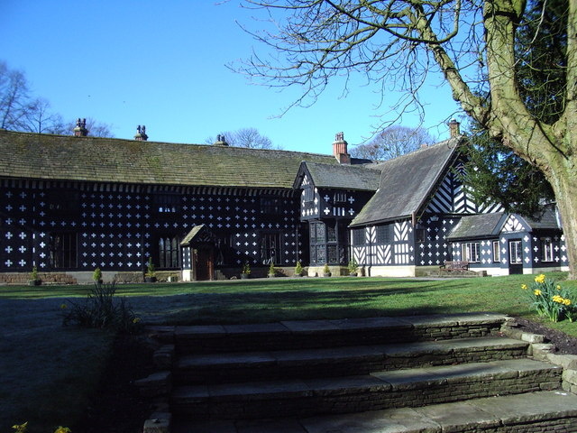 Extensive black-and-white timbered building.