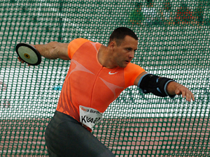 Zoltán Kővágó preparing to spin and throw the discus - Track and field