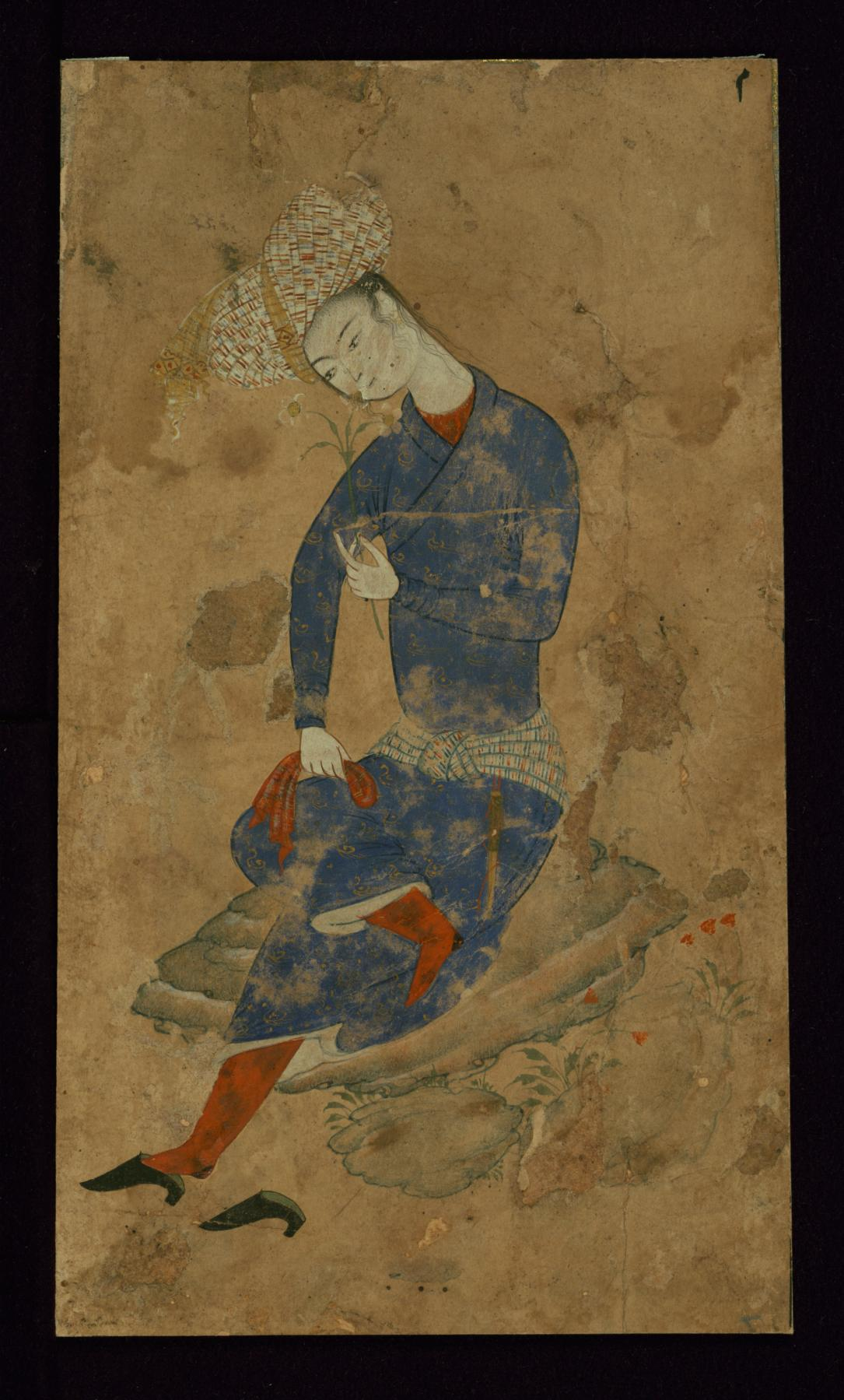 http://upload.wikimedia.org/wikipedia/commons/f/f9/Iranian_-_A_Young_Man_with_a_Flower_-_Walters_W680A_-_Full_Page.jpg
