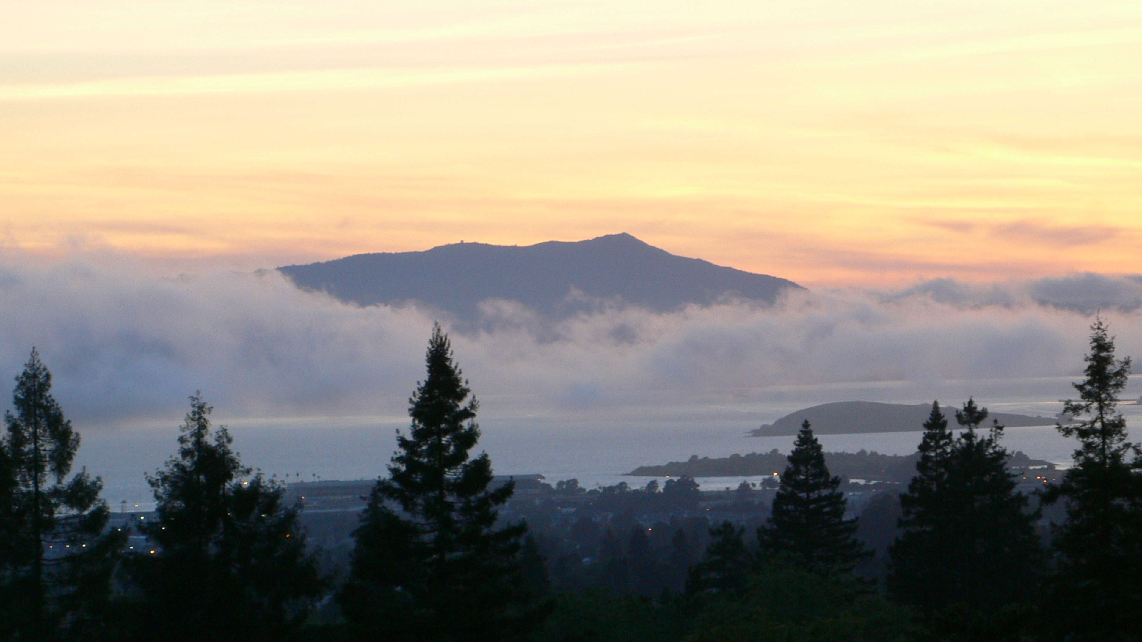 hikers on top of mt. tam at sunset