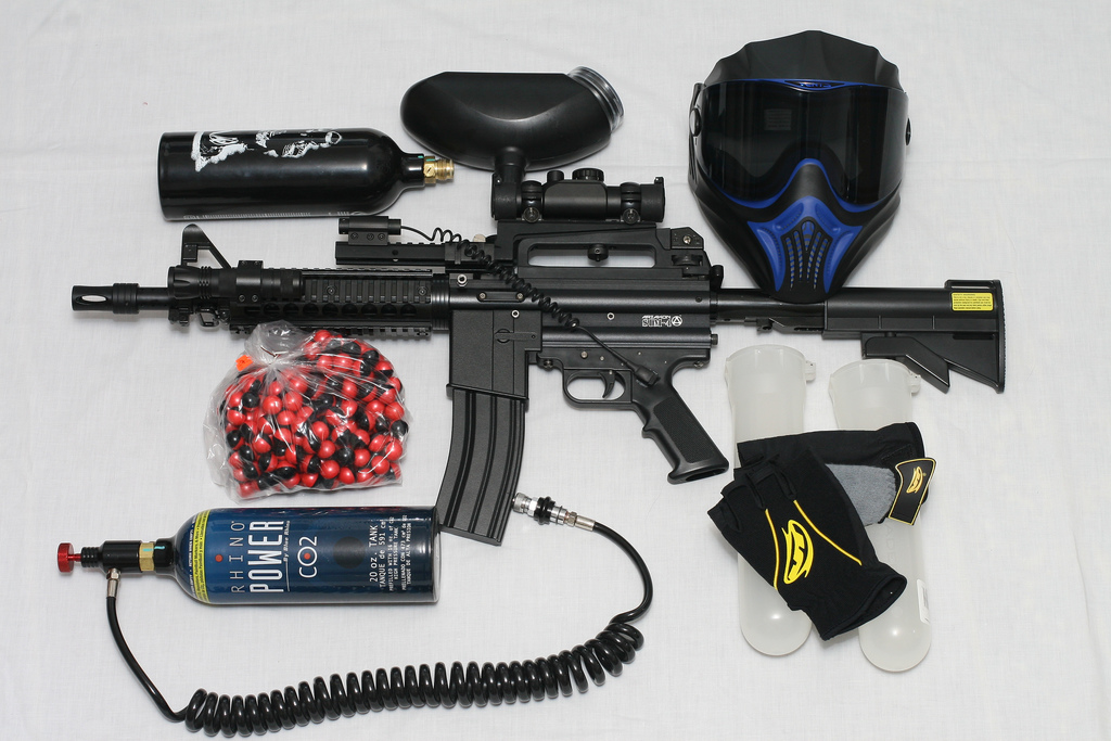 A paintball gun is used to fire a small ball of paint