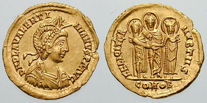Solidus minted in Thessalonica to celebrate Valentinian III's marriage to Licinia Eudoxia, daughter of the Eastern Emperor Theodosius II. On the reverse, the three of them in their wedding costume. Solidus ValentinianIII-wedding.jpg