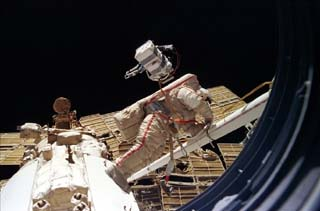 Anatoly Solovyev holds the record for time spent during spacewalks: 82+ hours over 16 separate outings, seen here performing an EVA outside Mir space station in 1997 SolovyevEVA.jpg