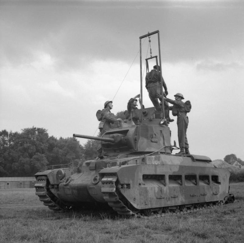 Extricating a casualty from the turret  of a Matilda tank