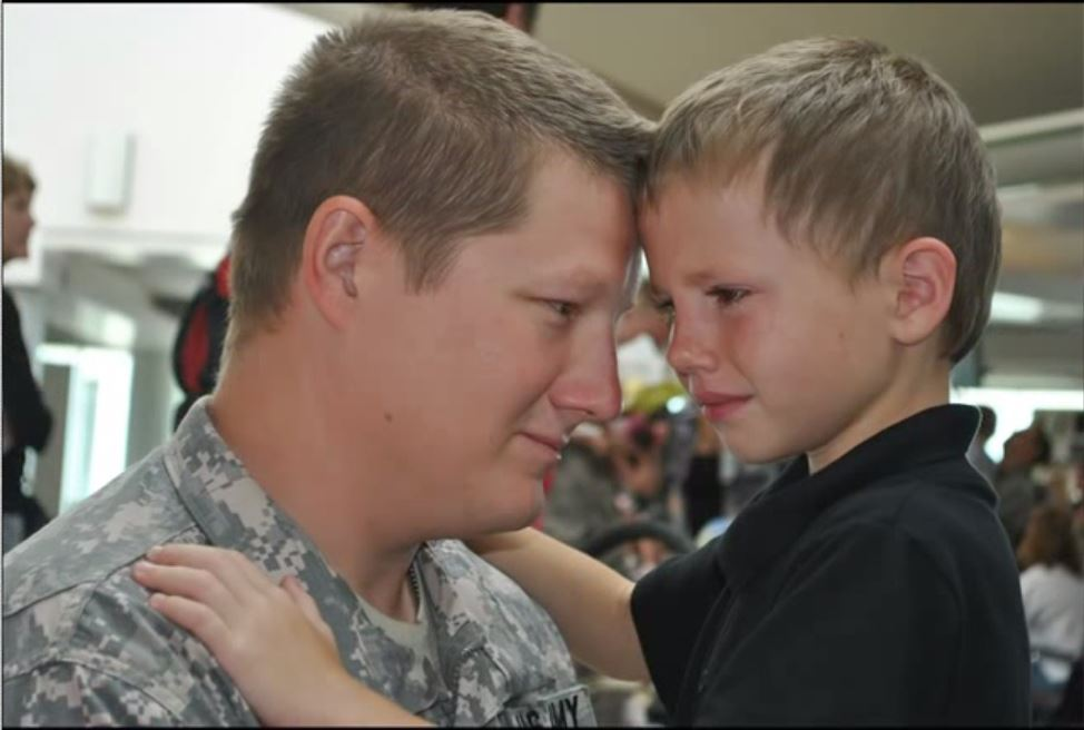 USARNG Sgt. Walter Singleton says a final goodbye to his son Seth shortly before deploying to Iraq in 2010