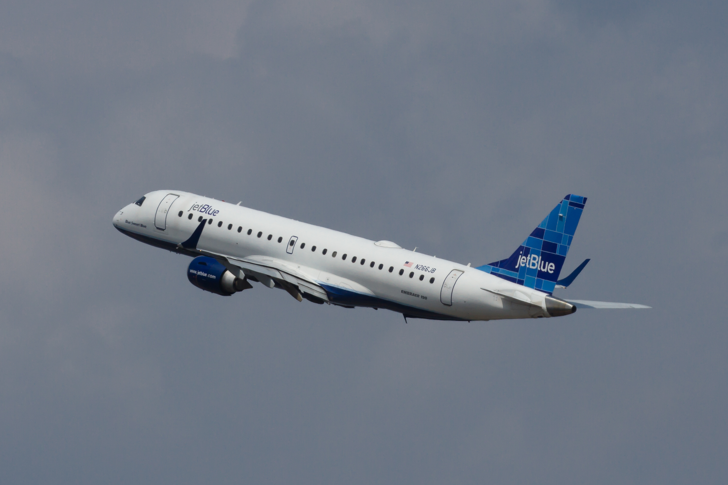 A JetBlue Embraer 190 taking off at Ronald Reagan Washington National  Airport in Washington D.C.
