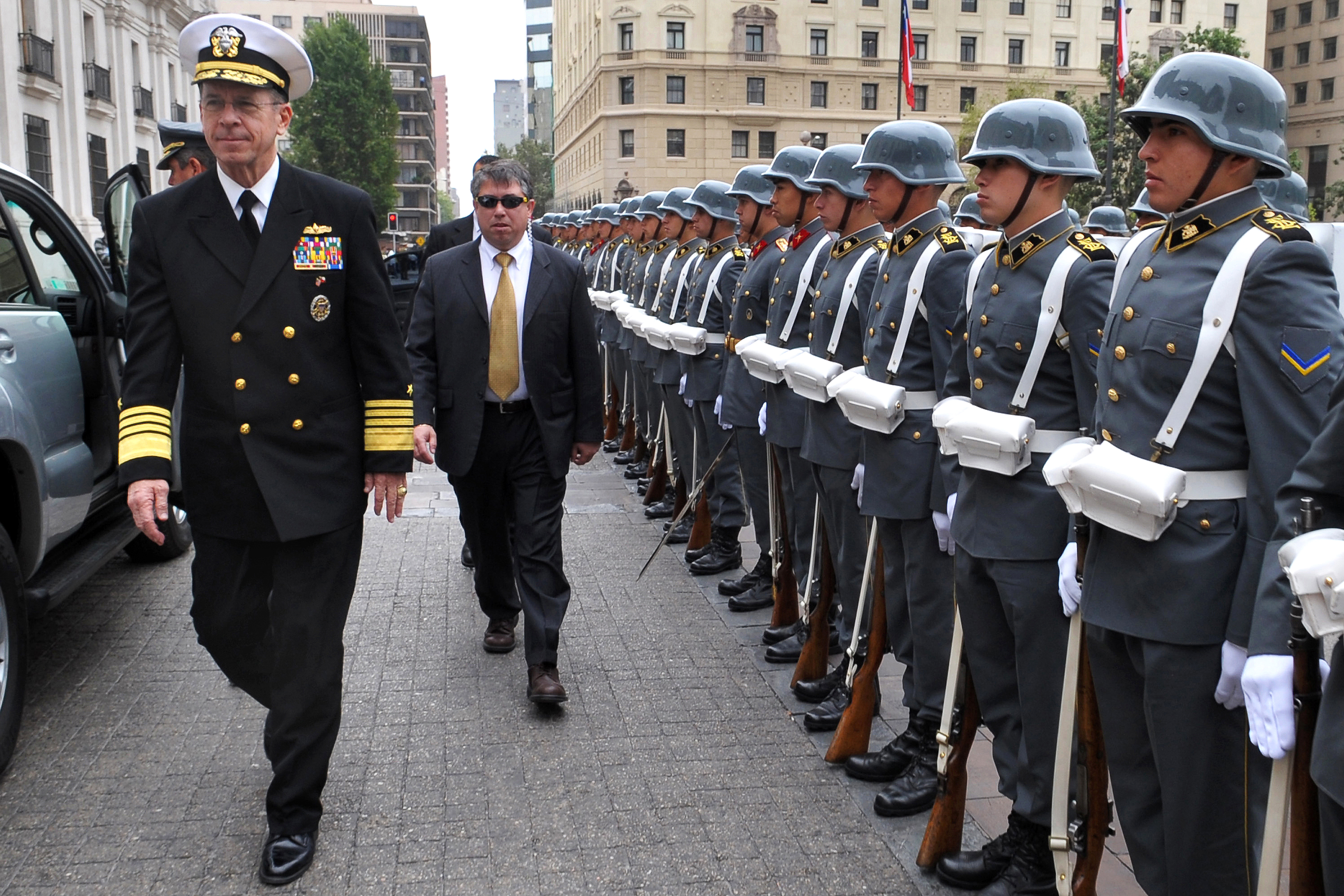 U.S. Navy Adm. Mike Mullen, Chairman of the Joint Chiefs of Staff, walks past a Chilean Honor Guard at the Chilean Army War College; March 3, 2009. –