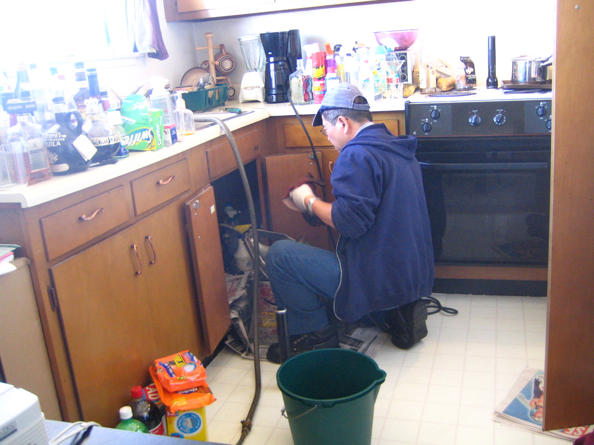 plumber working in the kitchen
