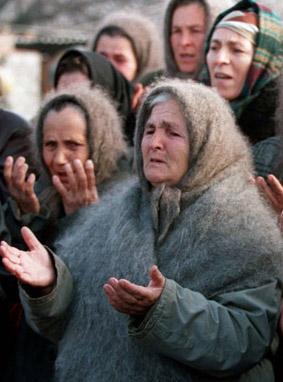 A group of women praying.