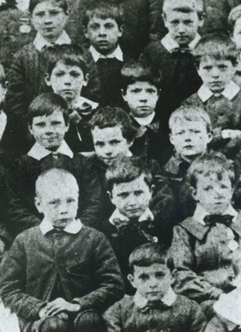 Seven-year-old Chaplin (middle centre, leaning slightly) at the Central London District School for paupers, 1897 Chaplin at Hanwell.jpg