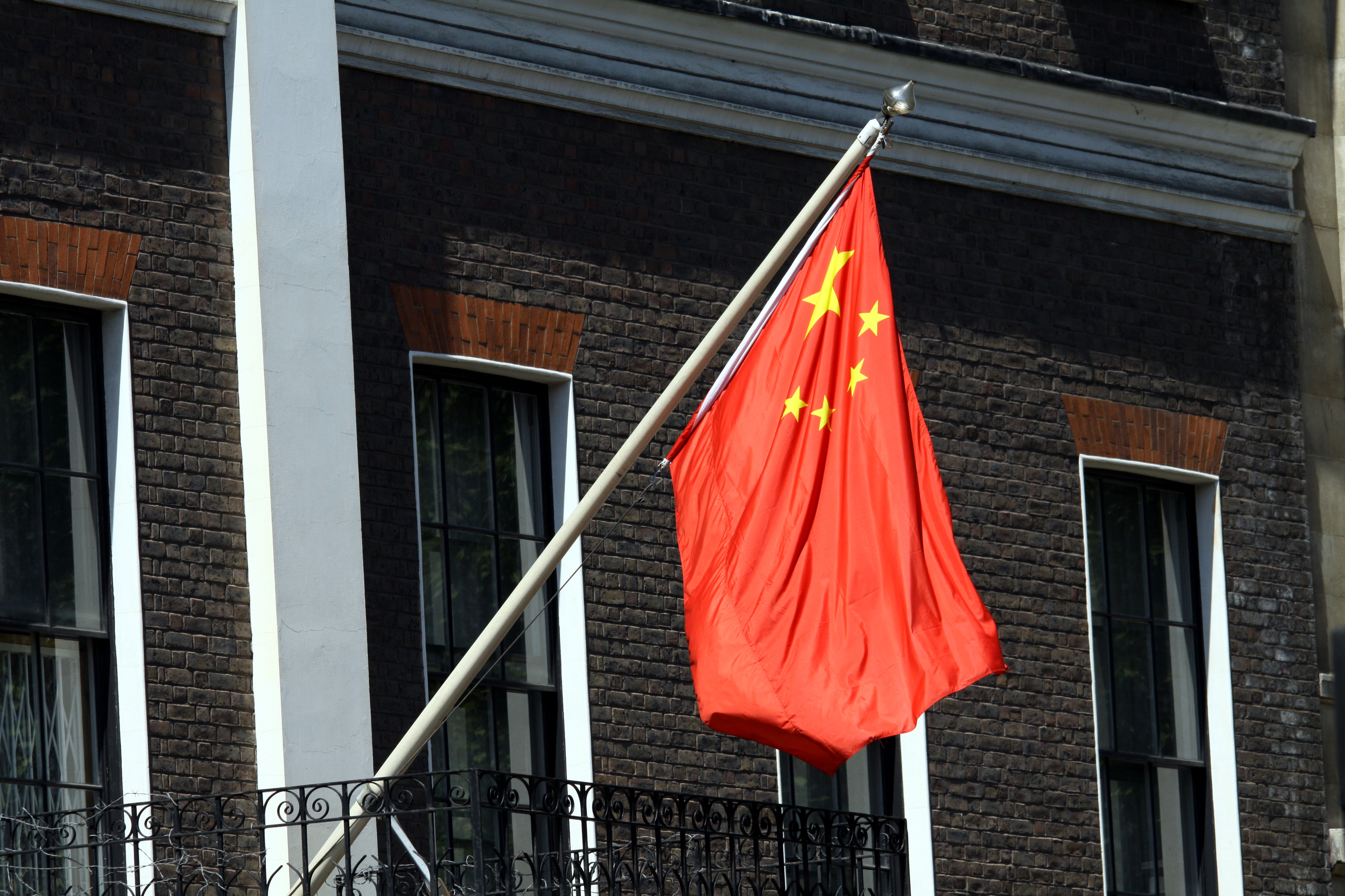 file chinese flag on the building of chinese embassy in
