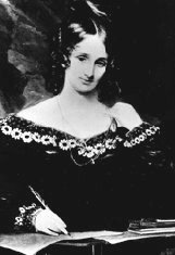 Black-and-white half-length portrait of a woman in a dress