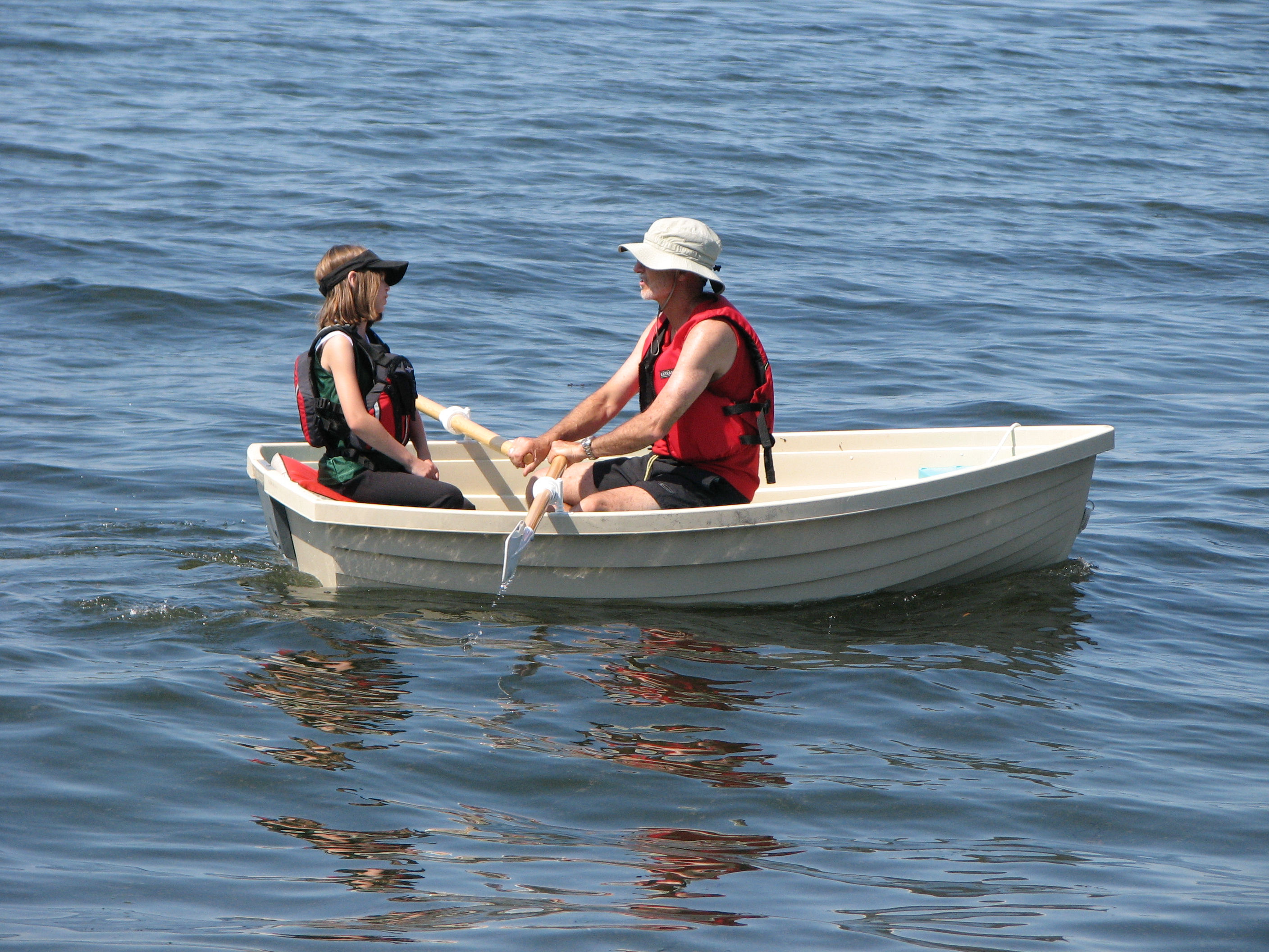 two girls paddling a boat